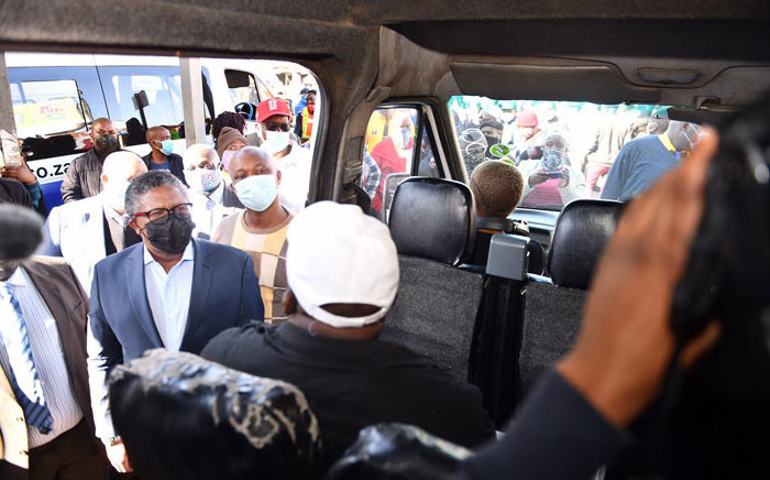 Transport Minister Fikile Mbalula checks up on passenger compliance with COVID-19 regulations at a taxi rank in Tshwane on 24 June 2021. Picture: @MbalulaFikile/Twitter