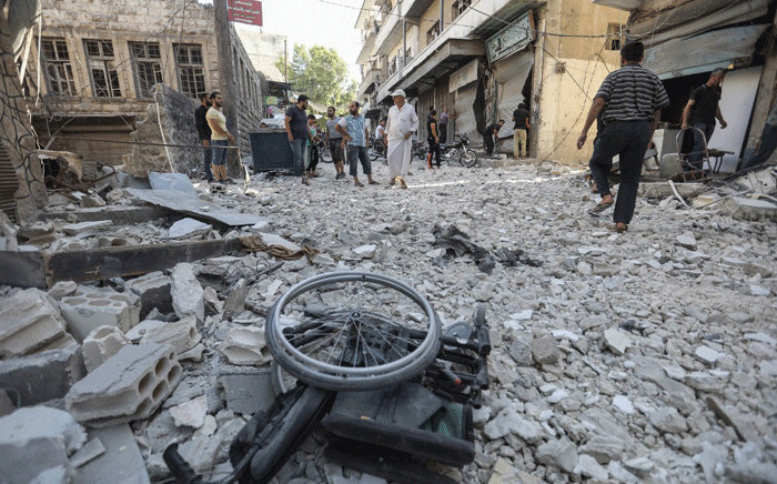 FILE: A wheelchair is seen amid the rubble of destroyed buildings following a reported regime air strike on the town of Ariha, in the south of Syria's Idlib province, on July 24, 2019. Picture: AFP.