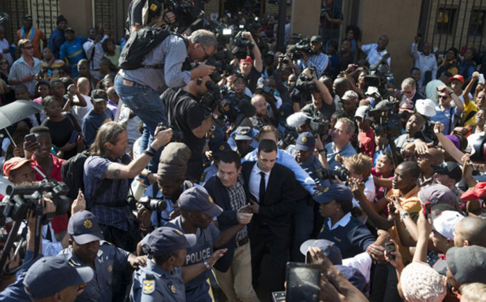 Oscar Pistorius leave the High Court in Pretoria on 11 September 2014. Picture: AFP.