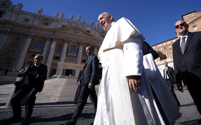 Pope Francis smiles during the weekly audience in Saint Peter's Square at the Vatican on 8 November 2017. Picture: AFP.