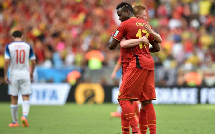 Goalscorer Belgiums forward Divock Origi (R) celebrates with teammate Belgiums midfielder Kevin De Bruyne after victory in the Group H football match between Belgium and Russia at the Maracana Stadium, Rio de Janeiro,22 June, 2014, during the 2014 FIFA World Cup. Picture: AFP.