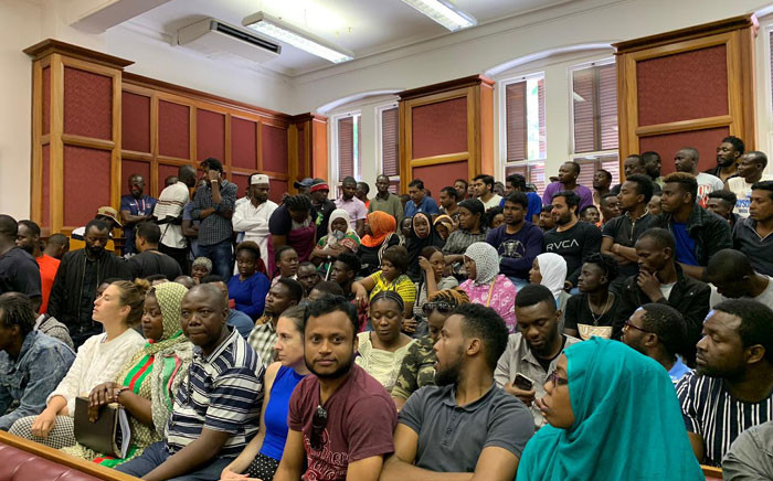 Foreign nationals seen in the crowd at the Western Cape High Court on 13 December 2019. Picture: Kaylynn Palm/EWN