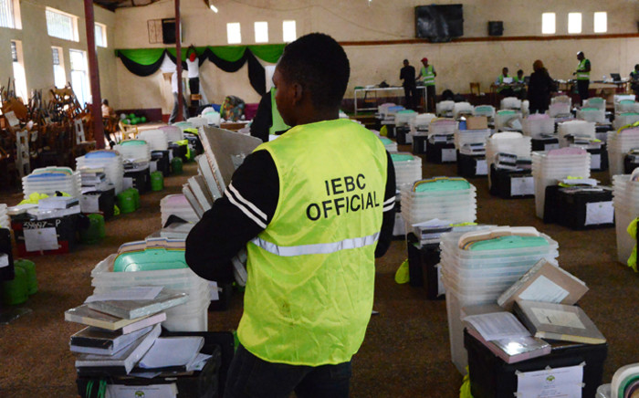 FILE: Kenya's Independent Electoral and Boundaries Commission officials make a sweep of electoral material 7 August 2017 at a holding centre in Kagio. Picture: AFP.