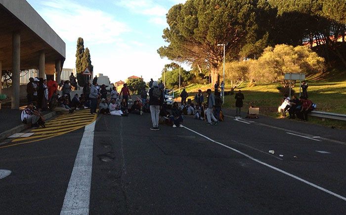 UCT students block the entrance on upper campus on 3 October 2016 during fees protests. Picture: Shamiela Fisher/EWN.