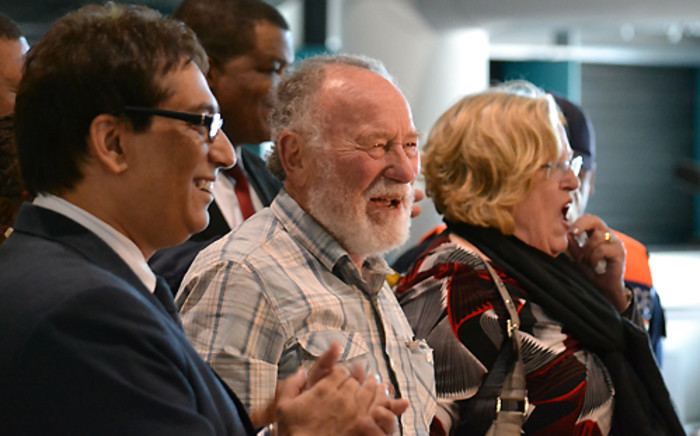 Prof Cyril Karabus arrives at Cape Town International Airport on 17 May 2013 following a legal battle in the UAE. Picture: Aletta Gardner/EWN