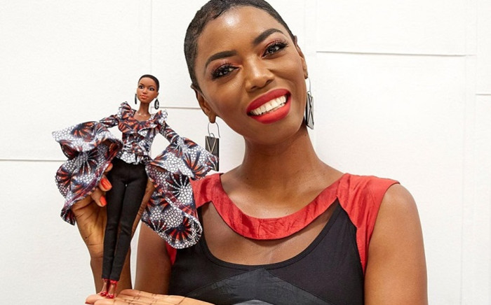 Lira and her own Barbie doll. Picture: Lira/Facebook