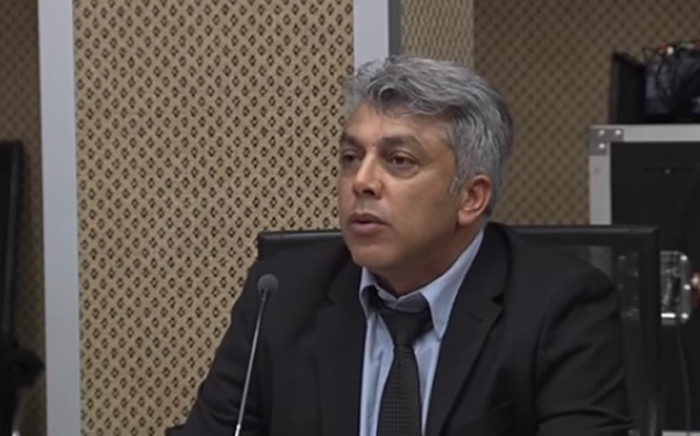A screengrab of Sars fraud investigator Yousaf Denath giving evidence at the Nugent inquiry on 26 September 2018.