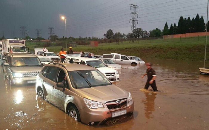 FILE: Emer-G-Med paramedics clear cars stuck on flooded roads on the N3 near Linksfield. Picture: @EMER_G_MED.