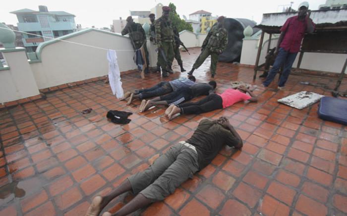 Kenyan police officers arrest Muslim youths at Masjid Shuhada mosque in the coastal city of Mombasa, Kenya, 17 November 2014. Picture: EPA.