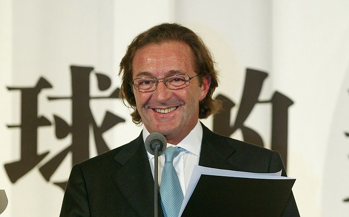 In this photo taken on 30 November 2004 Gerald Marie, former president of Elite Model Group, gives a press conference in Shanghai. Picture: AFP.