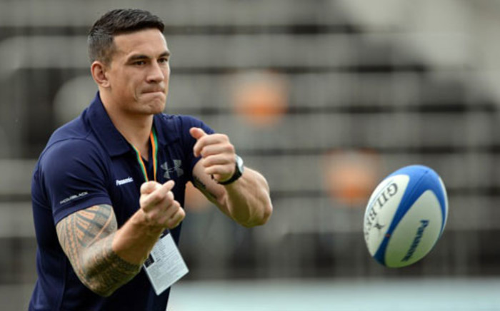 All Blacks centre Sonny Bill Williams passes the ball to his new team mates of Japanese rugby union team Panasonic Wild Knights in Tokyo on 1 September, 2012. Picture: AFP.