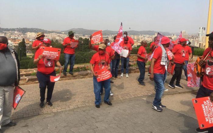 Nehawu members picket outside the Union Buildings in Pretoria on 21 September 2020. Picture: Edwin Ntshidi/EWN