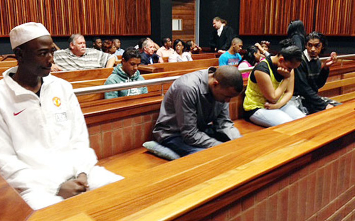 The four people accused of killing Kirsty Theologo in 2011 in court during the passing of judgment on 7 November 2013. Picture: Vumani Mkhize/EWN.