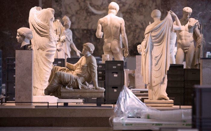 A photo taken on 3 June 2016 shows boxes containing valuable artworks from the Louvre reserves stored among status in one of the museum's room of the Department of Greek, Etruscan, and Roman Antiquities room after they were evacuated from the basement following days of heavy rains which led the River Seine to reach its highest level in three decades. Picture: Geoffroy van der Hasselt/AFP.