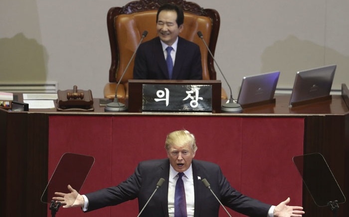 US President Donald Trump (C) addresses the National Assembly in Seoul on November 8, 2017. Picture: AFP