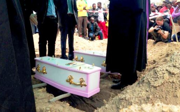 The tiny coffins of Yonelisa and Zandile Mali are pictured shortly before burial on 19 October 2013. The young cousins were found raped and murdered in Diepsloot earlier in the week. Picture: Lesego Ngobeni/EWN