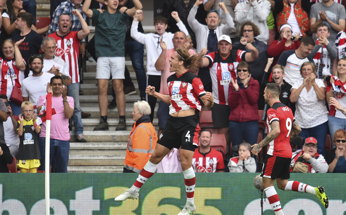 Southampton's Danish defender Jannik Vestergaard (L) celebrates scoring their first goal to equalise 1-1 during the English Premier League football match between Southampton and Manchester United at St Mary's Stadium in Southampton, southern England on 31 August 2019. Picture: AFP.