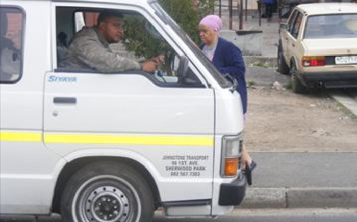 A taxi picks up a commuter in Johannesburg. Picture: EWN