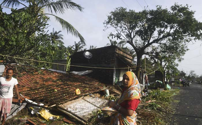 Villagers gather in front of a collapsed house after Cyclone Bulbul hit the area in Bakkhali on November 10, 2019. Three people have died and two million others spent a night huddled in storm shelters as Cyclone Bulbul smashed into the coasts of India and Bangladesh with fierce gales and torrential rains, officials said on 10 November. Picture: AFP