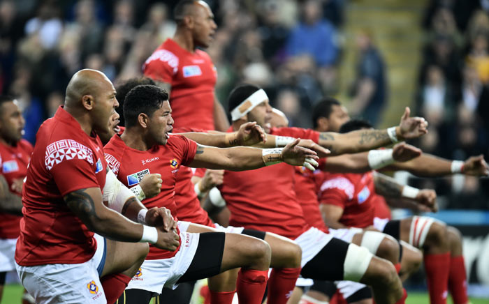 Tonga's players perform the sipi tau prior to a Pool C match of the 2015 Rugby World Cup between New Zealand and Tonga at St James' Park in Newcastle-upon-Tyne, northeast England, on 9 October 2015. Picture: AFP