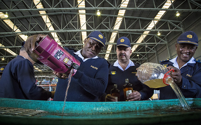 FILE: Cape Town law enforcement officials dispose of 10,000 litres of confiscated alcohol. Picture: Thomas Holder/EWN.