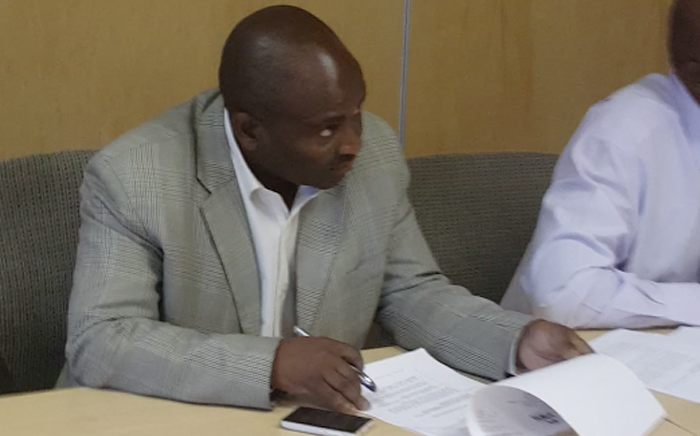 A screengrab of Brigadier Nyameka Xaba, head of the Hawks CATS (Crimes Against the State) unit, who was allegedly involved in preventing Sars employee Vlok Symington from leaving a boardroom.