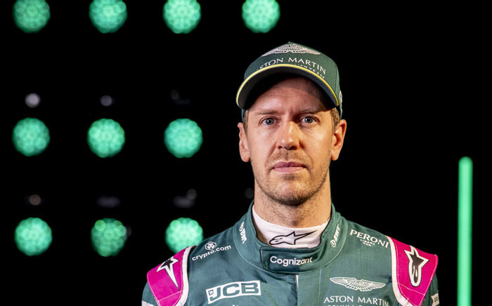 A handout photograph released by Aston Martin Cognizant Formula One Team on 3 March 2021 shows German driver Sebastian Vettel posing in front of the AMR21, their new car for the 2021 Formula One season, during a virtual launch event at their headquarters in Gaydon, central England. Picture: Glenn Dunbar/ASTON MARTIN/AFP