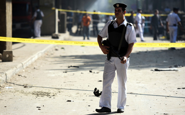 FILE: An Egyptian policeman stands guard at the site of a powerful bomb explosion, that ripped through the Italian consulate, killing one person, in the Egyptian capital, Cairo, on 11 July, 2015. Picture: AFP.