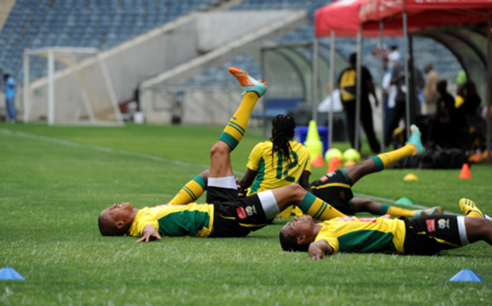 Bafana players stretch at a training session at the Orlando Stadium in Soweto on Friday, 11 January 2013. The team will play a friendly match against Algeria at the venue on Saturday. Bafana Bafana face the Cape Verde Islandsin the African Cup of Nations opener at the National Stadium on January 19.Picture: Werner Beukes/SAPA