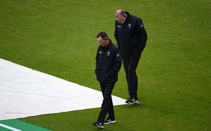The umpires are on the outfield inspecting the field. Picture: @cricketworldcup/Twitter.