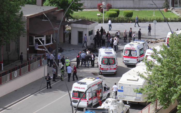 """Ambulances are parked outside the police headquarters in the southeastern Turkish city of Gaziantep on May 1, 2016 after a bomb exploded, killing at least one police officer. Picture: AFP."""""""