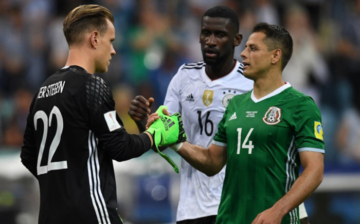 Germany's goalkeeper Marc-Andre Ter Stegen shakes hands with Mexico's forward Javier Hernandez after the 2017 Confederations Cup semi-final football match between Germany and Mexico at the Fisht Stadium in Sochi on June 29, 2017. Pictured: AFP