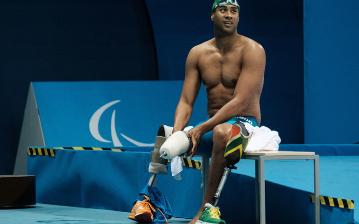 FILE: South Africa's Achmat Hassiem puts on his prosthesis after competing a heat of men's 100 m freestyle (S10) of the Rio 2016 Paralympic Games at Olympic Park in Rio de Janeiro on 13 September 2016. Picture: Yasuyoshi Chiba/AFP