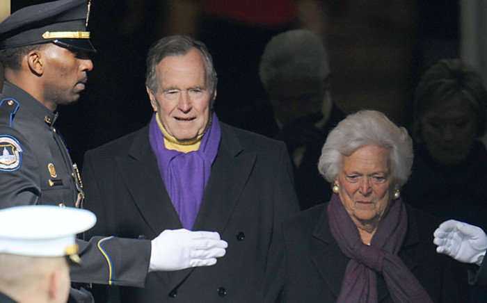 Former US president George H.W. Bush and his wife Barbara arrive for the inauguration of Barack Obama as the 44th US president at the Capital in Washington on January 20, 2009. Picture: AFP.