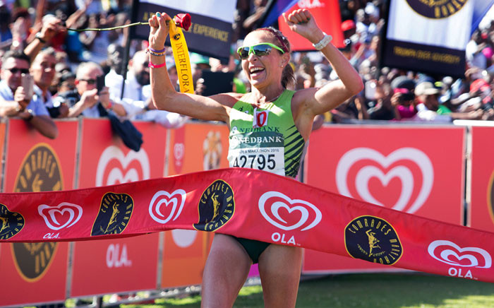 South African long distance runner Charne Bosman crosses the line to win the women' race of the Comrades Marathon, 89km from Pietermaritzburg to Durban, on May 29, 2016 in Durban. Bosman won the women' race in 6 hours, 25 minutes and 55 seconds. Picture: AFP