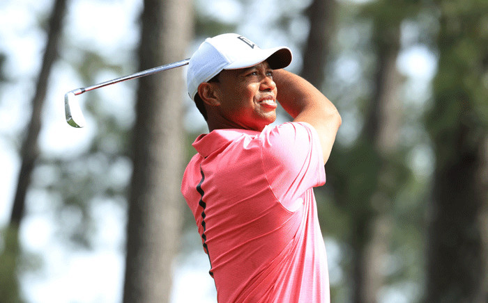 Tiger Woods of the United States plays his shot from the fourth tee during a practice round prior to the start of the 2018 Masters Tournament at Augusta National Golf Club on 2 April 2018 in Augusta, Georgia. Picture: AFP