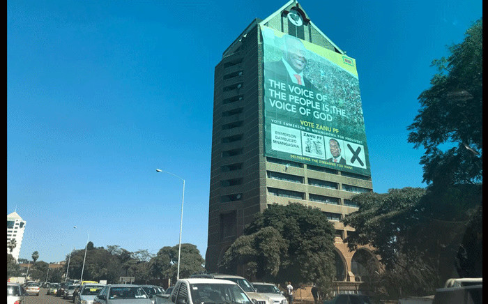 A poster of Zimbabwean President Emmerson Mnangagwa seen on a building in Harare. Picture: Masechaba Sefularo/EWN.