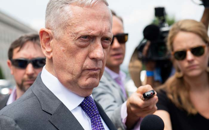 FILE: Jim Mattis speaks to the press outside of the Pentagon in Washington, DC, on 7 August 2018. Picture: AFP.