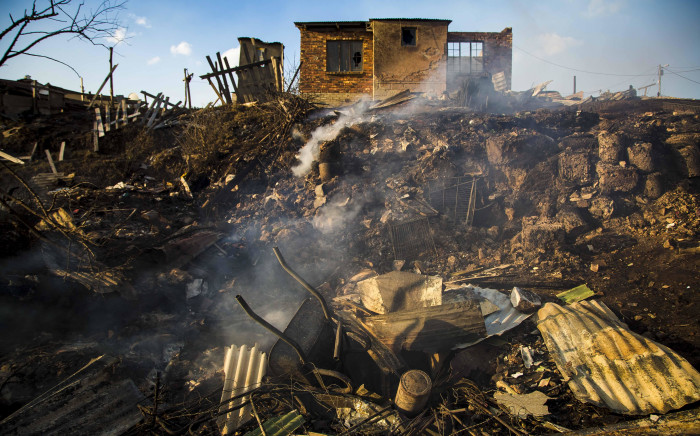 A wheel barrow sits abandoned in White Location, an informal settlement in Knysna, that lost 40 shacks to the fire. Picture: Thomas Holder/EWN