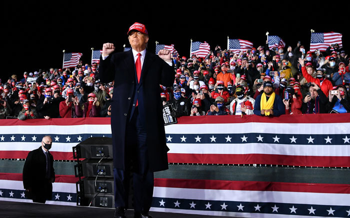 US President Donald Trump gestures during a rally at Southern Wisconsin Regional Airport in Janesville, Wisconsin on 17 October 2020. Picture: AFP