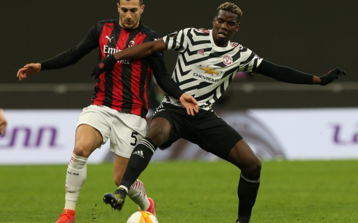 Manchester United's Paul Pogba with AC Milan's Diogo Dalot Thursday, 18 March 2021. Picture: Twitter/@ManUtd