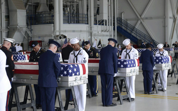 Military honour guards carry the remains of American soldiers repatriated from North Korea during a repatriation ceremony after arriving to Joint Base Pearl Harbor-Hickam, Honolulu, Hawaii, on 1 August, 2018. Picture: AFP.
