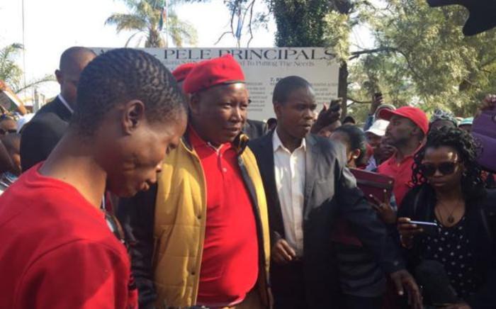 EFF leader Julius Malema outside the Marikana police station. Picture: Louise McAuliffe/EWN.