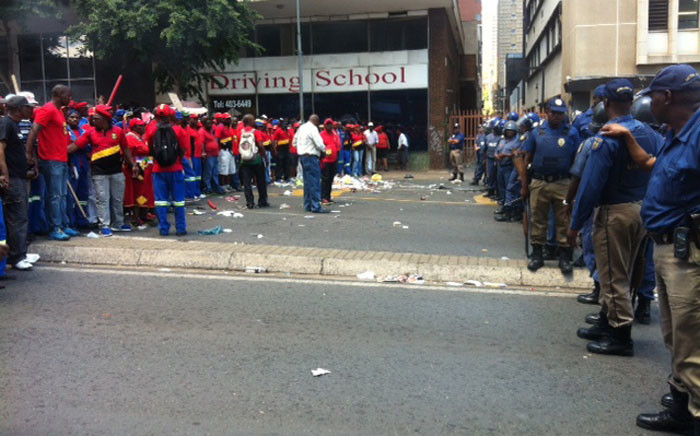 FILE: Police stand off with striking Pikitup members in Braamfontein. Picture:Kgothatso Mogale/EWN