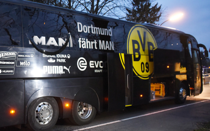 Borussia Dortmund's damaged bus is pictured after an explosion some 10km away from the stadium prior to the Uefa Champions League 1st leg quarter-final football match BVB Borussia Dortmund v Monaco in Dortmund, western Germany on 11 April 2017. Picture: AFP.