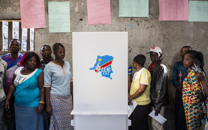 FILE: People wait to vote at Katendere polling station in Goma on 30 December 2018, during Democratic Republic of Congo's general elections. Picture: AFP.