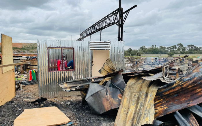 Booysens residents rebuild their homes after a devastating fire in their informal settlement. Picture @CityofJoburgEMS on Twitter.