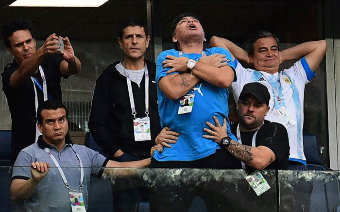 Former Argentina forward Diego Maradona celebrates the opening goal during the Russia 2018 World Cup Group D football match between Nigeria and Argentina at the Saint Petersburg Stadium in Saint Petersburg on 26 June, 2018. Picture: AFP.