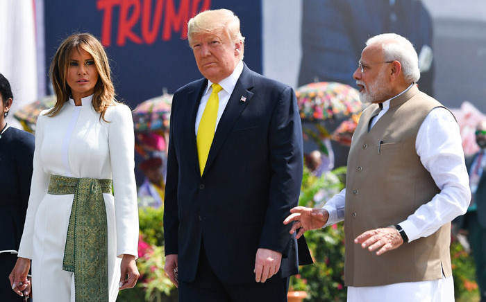 India's Prime Minister Narendra Modi (R) speaks with US President Donald Trump (C) and First Lady Melania Trump (L) upon their arrival at Sardar Vallabhbhai Patel International Airport in Ahmedabad on 24 February 2020. Picture: AFP