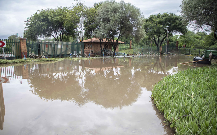 Kwikkie crescent behind the Outsurance offices flooded by Hennops River in Centurion on 9 December 2019. Picture: Abigail Javier/EWN.